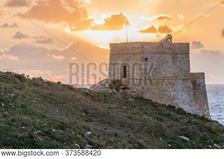 Sunset At The Xlendi Tower On The Island Of Gozo, Malta