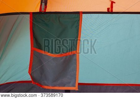 Mesh Bag In Tent Used For Storing Equipment For Ease Of Use.