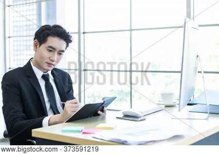 Happy Mood A Cheerful Of Asian Young Businessman Have Ideas Make A Note The Successful Business Plan