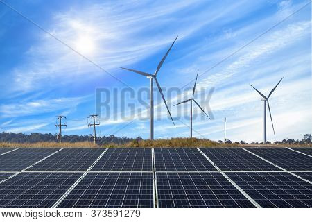 Photovoltaic Modules Solar Power Plant With Wind Turbines Against And Blue Sky With Cloud,alternativ