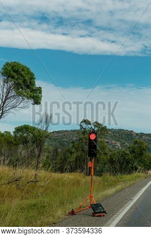 A Red Electronic Stop Sign At Roadworks On A Rural Highway