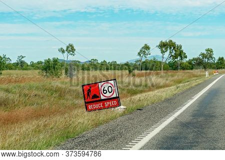 A Sign Warning Of Roadworks Ahead And For Motorists To Reduce Speed To 60 Kilometers Per Hour On A C