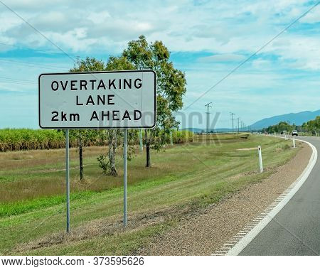 Overtaking Lane 2 Km Ahead Roadside Sign On A Country Highway