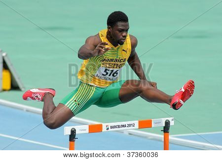 BARCELONA - JULY, 11: Jarvan Gallimore of Jamaica during 400m hurdles event of the 20th World Junior Athletics Championships at the Stadium on July 11, 2012 in Barcelona, Spain