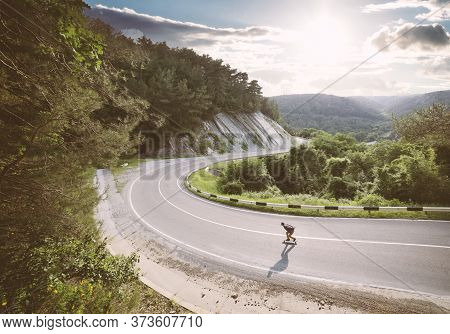 Young Man Go Downhill On A Longboard.
