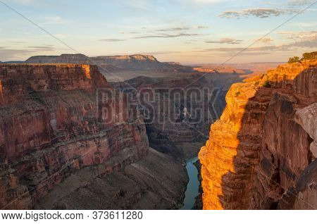 Grand Canyon Panorama And Colorado River At Sunrise From Remote Toroweap Point Of National Park, Uta