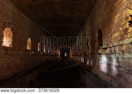 Old Ruined Brick Vaulted Tunnel. Dark Passage. Underground Communication