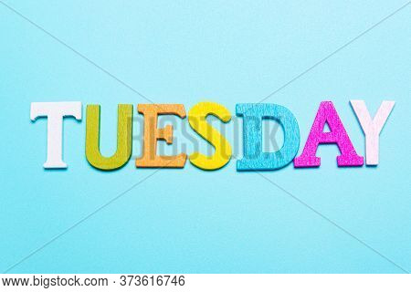 Word Tuesday In Multicolored Letters On A Blue Background