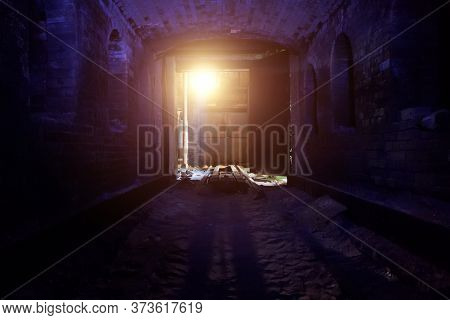 Old Ruined Brick Vaulted Tunnel. Dark Passage. Underground Communication. Light At The End