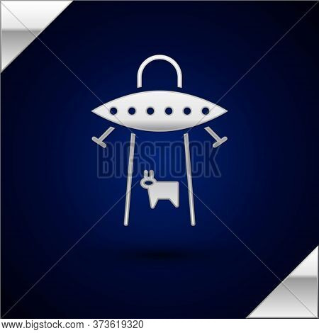 Silver Ufo Abducts Cow Icon Isolated On Dark Blue Background. Flying Saucer. Alien Space Ship. Futur