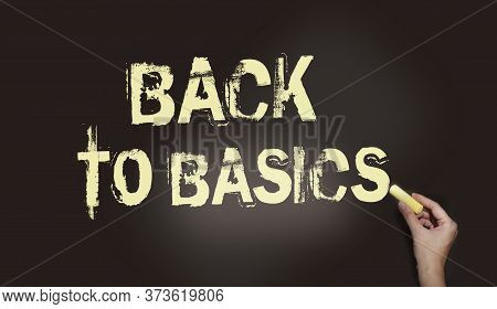 Back To Basics Written With Chalk On Blackboard. Elementary School Education Or Small Business First
