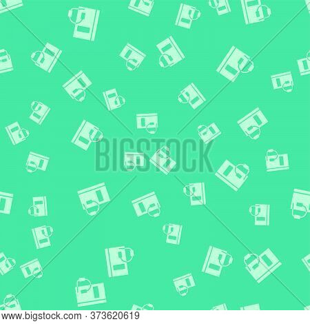 Green Audio Book Icon Isolated Seamless Pattern On Green Background. Book With Headphones. Audio Gui