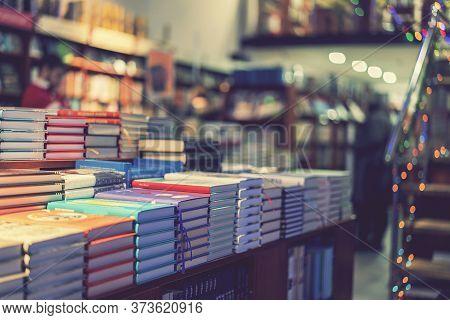 Lot Of New Books In Hardcover. Image Of Abstract Blur People At Book Store In Shopping Mall For Back