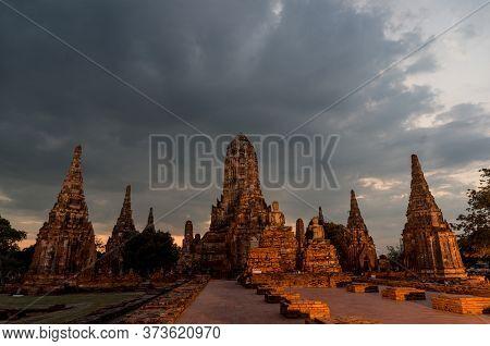 Old Ruines Of Wat Chai Wattanaram Temple On Sunset. Thailand World Heritage Landmark