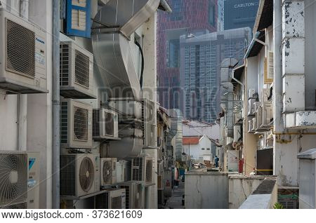 Singapore, Singapore - December 23, 2015: Singapore Backstreet With Air Conditioning, Cooling System