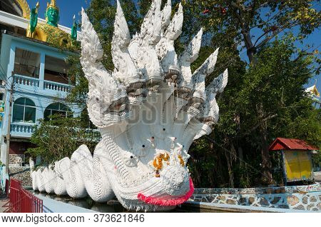 Hua Hin, Thailand - December 28, 2015: Mythological Creature With Snake Heads In Wat Etisukatow Temp