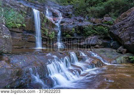Tropical Waterfall In The Gorge. Nature Background. Wentworth Falls Waterfall In Blue Mountains, Aus