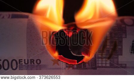 Burning Euros, Global Financial Crisis And Inflation, Concept. Money Banknote On A Black Background,