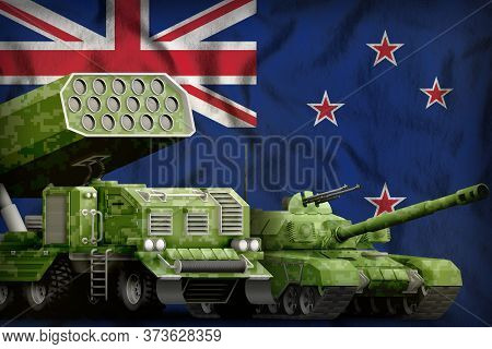 Tank And Missile Launcher With Summer Pixel Camouflage On The New Zealand Flag Background. New Zeala