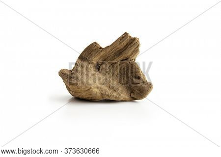 Piece of driftwood, isolated on white.