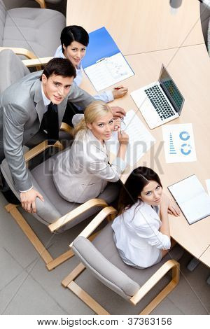 Business people at the team meeting discuss current issues at the modern office building. Communication concept