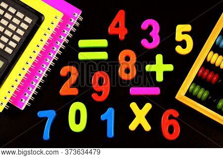 Learning To Count. Mathematical Calculations At School In The Classroom. Calculator And Abacus For S