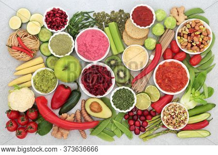 Vegan food for health and fitness and ethical eating concept with foods high in protein, anthocyanins, vitamins, smart carbs, minerals, antioxidants and fibre. Flat lay.