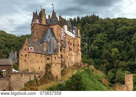 Fairytale Castle Eltz On The Moselle, Germany, With Dramatic Sky