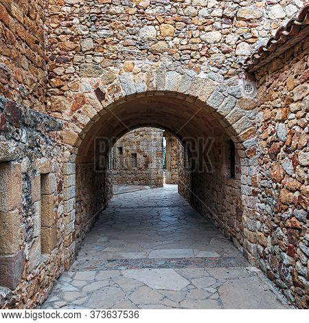 Castle De Pals, Historic Stone Walls And Arches , Pals, Spain