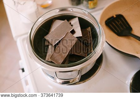 Chocolate Bars Are Melted In A Glass Bowl On A Steam Bath.
