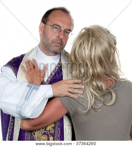 a catholic priest in love with girlfriend. symbol photo celibacy