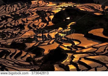 Sunrise Over Rice Terraces In Duoyishu Scenic Area In Yunnan Region, China. This Scenic Area Is The