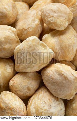 Whole peeled Asian kukui nuts close up full frame