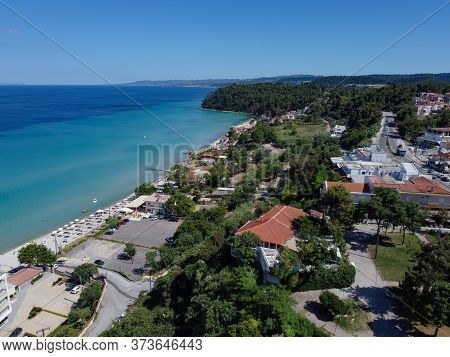 Chalkidiki, Greece Coastal Village Landscape Drone Shot With Pine Trees. Aerial Day View Of Kallithe