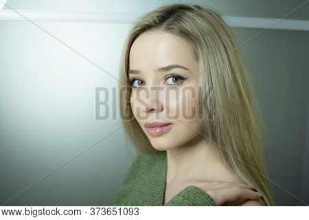Portrait Of A Beautiful Young Woman. A Girl With Healthy Long Blond Hair.