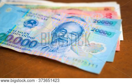 Banking, Investment In Vietnam. Vietnamese Currency With The Image Of Ho Chi Minh On It, On Top Of O