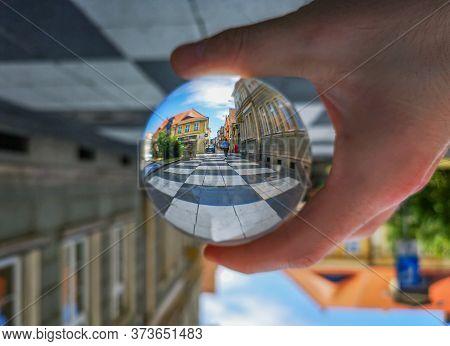 Zielona Gora Poland 8 June 2019 Chessboard Sidewalk Reflected In Crystal Glass Lensball