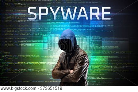 Faceless hacker with SPYWARE inscription on a binary code background