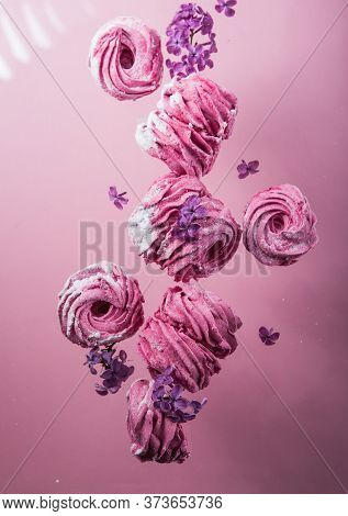 Russian Pink Zephyr On Pink  Background. Set Of Homemade Marshmallow Meringue, Pansy. Sweetness Cusi