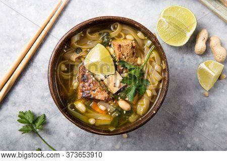 Miso Ramen Asian Noodles Soup With Tempeh Or Tempe  In A Bowl. Health Food For Healthy Eating For Ve