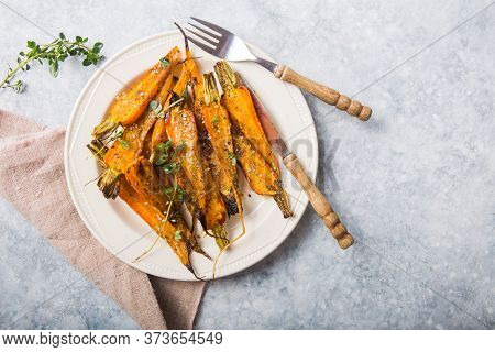 Still Life Of Roasted Baby Carrots With A Herb And Honey Glaze.roasted Carrots With Fresh Herbs, Tra