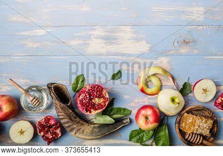 Rosh Hashanah  (hashana) - Jewish New Year Holiday Concept. Traditional Symbols: Honey Jar And Fresh