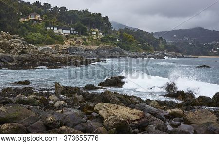Zapallar, Chile - May 9, 2014: Houses Snuggle Around The Coast In The Peaceful Town Of Zapallar On T