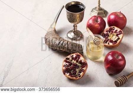 Rosh Hashanah - Jewish New Year Holiday Concept. Traditional Symbols: Honey Jar And Fresh Apples Wit