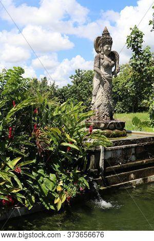Dewi Sri Or Shridevi The Rice Goddess. Stone Figure Of One Of Balinese Godness. Water Palace Of Tirt