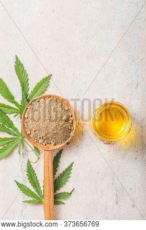 Hemp Flour  In Wooden Spoon And Hemp Essential Oil.  Copy Space. Cbd Cannabis.hemp Flour In Wooden B