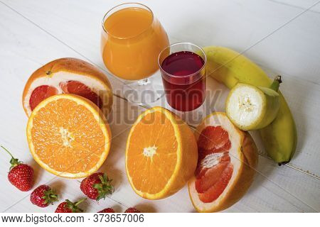 Fresh Fruits. Healthy Food. Mixed Fruit, Strawberries And Banana, Citruses. Studio Photography Of Va