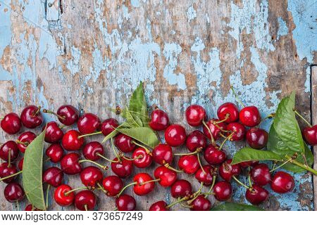 Creative Fresh Cherry Pattern Background With Copy Space. Top View.fresh Red Cherries. Texture Cherr