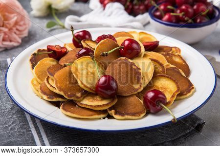 Cereal Mini Pancakes. Trendy Food, Mini Cereal Pancakes With Cherry In Bowl On The Table, Grey Cemen