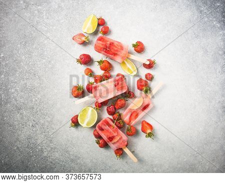 Strawberry Popsicle. Berry Popsicle With Wooden Sticks On Concrete Counter. Homemade Strawberry Froz